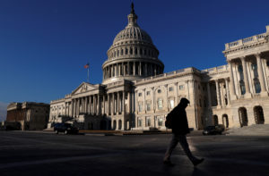 People walk by the U.S. Capitol building in Washington, D.C. Photo by Leah Millis/Reuters