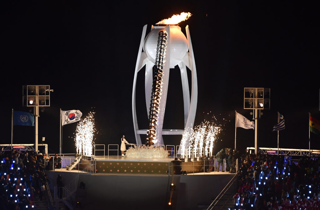Former figure skater Yuna Kim of South Korea lights the cauldron during the opening ceremony of the Winter Olympics in Pyeongchang, South Korea on Feb. 9. Photo by Toby Melville/Reuters