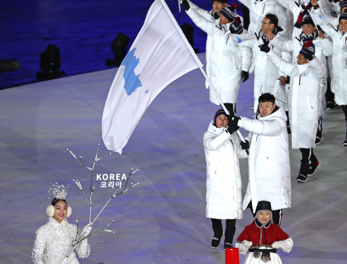 Athletes from North and South Korea walk together under a unified flag in the Olympics opening ceremony on Feb. 9. Photo by Damir Sagolj/Reuters