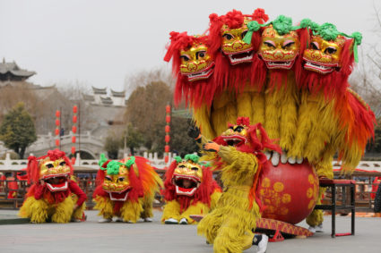 Folk artists perform a lion dance ahead of the Chinese Lunar New Year, or Spring festival, at Taierzhuang Ancient Town scenic area in Zaozhuang, Shandong province, China. REUTERS/Stringer