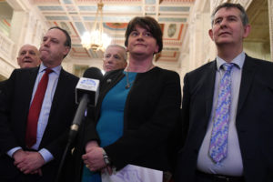 DUP leader Arlene Foster (center) arrives at a news conference in Parliament Buildings at Stormont in Belfast, Northern Ireland on Feb. 12. Photo by Clodagh Kilcoyne/Reuters