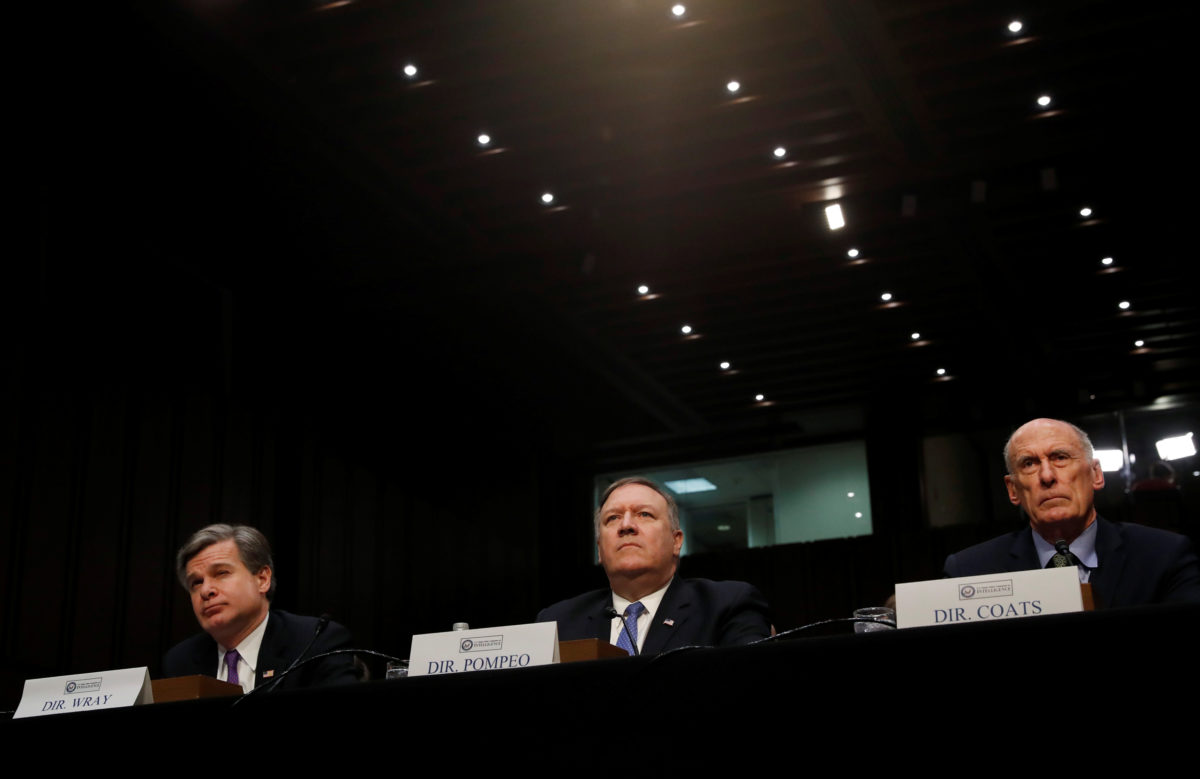 "Federal Bureau of Investigation (FBI) Director Christopher Wray; Central Intelligence Agency (CIA) Director Mike Pompeo; and Director of National Intelligence (DNI) Dan Coats testify before a Senate Intelligence Committee hearing on ""World Wide Threats"" on Capitol Hill in Washington, D.C. Photo by Leah Millis/Reuters"