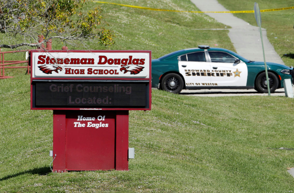 A message about grief counseling appears on the electronic signboard at Marjory Stoneman Douglas High School one day after a shooting at the school left 17 dead in Parkland, Florida, February 15, 2018. Photo by Jonathan Drake/Reuters