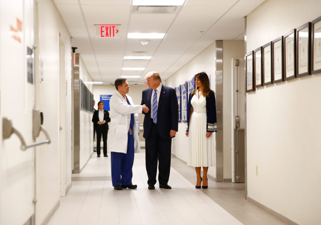 U.S. President Donald Trump and first lady Melania Trump visit with medical staff of Broward Health North Hospital in the ...