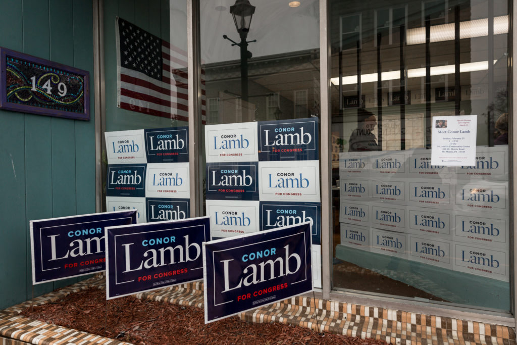 Signs adorn the entrance to Congressional candidate Conor Lamb's headquarters at 149 East High Street in Waynesburg, Pennsylvania, U.S., February 14, 2018. Picture taken February 14, 2018. REUTERS/Maranie Staab - RC19C87255A0