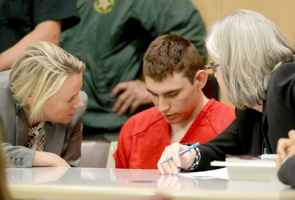 Nikolas Cruz, facing 17 charges of premeditated murder in the mass shooting at Marjory Stoneman Douglas High School in Parkland, Florida, appears in court for a status hearing in Fort Lauderdale, Florida. Photo by Mike Stocker/Reuters