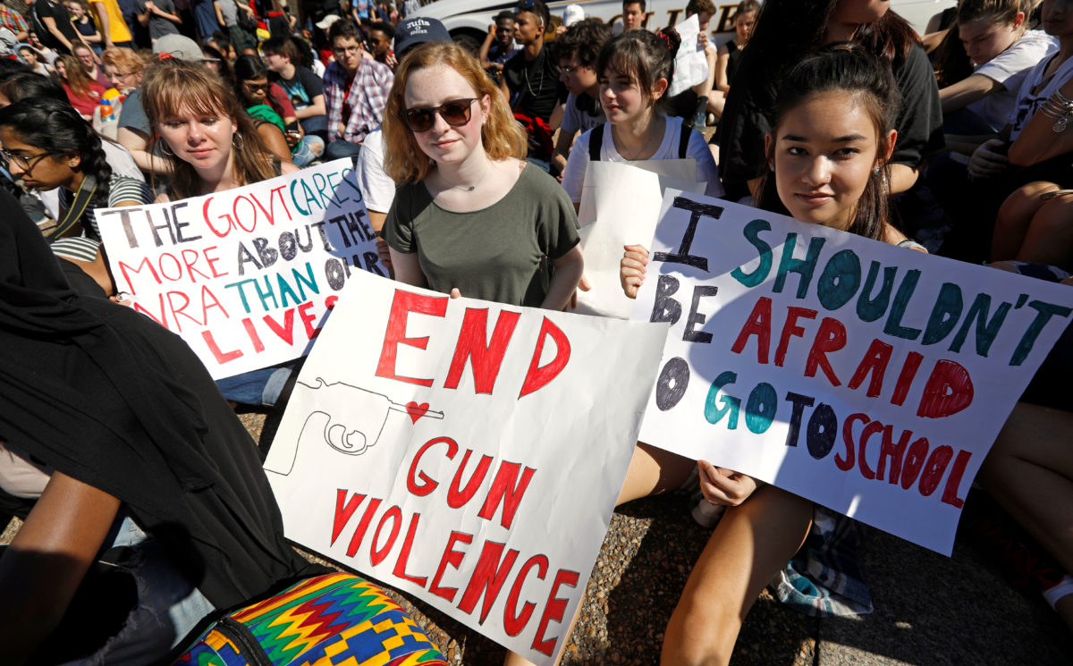 Students who walked out of their Montgomery County, Maryland, schools protest against gun violence in front of the White House in Washington, U.S., February 21, 2018. Kevin Lamarque/Reu