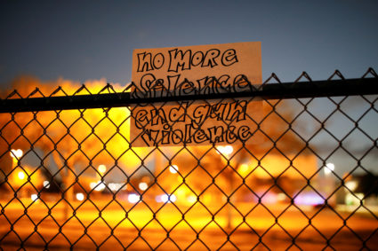 A note is seen on the fence of the Marjory Stoneman Douglas High School following a mass shooting, in Parkland, Florida. Photo by Carlos Garcia Rawlins/Reuters