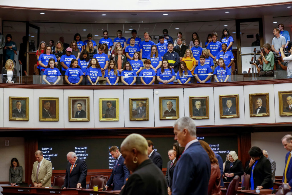 Students and their chaperones from Marjory Stoneman Douglas High School, wearing blue t-shirts, stand in the gallery above the Florida Senate as the Senate holds a moment of silence to honour the victims of last week's mass shooting on the school's campus, in Tallahassee, Florida. Photo by Colin Hackley/Reuters