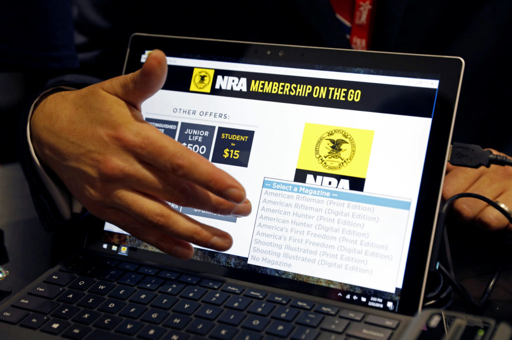 Attendees sign up for NRA memberships at the Conservative Political Action Conference (CPAC) at National Harbor, Maryland,  U.S., February 22, 2018.  REUTERS/Kevin Lamarque - RC1D7CFCABC0