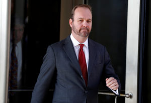 Rick Gates, former campaign aide to President Donald Trump departs after a bond hearing at U.S. District Court in Washington on December 11, 2017. Photo by Joshua Roberts/Reuters