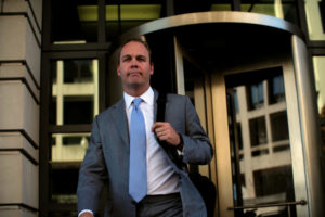 FILE PHOTO: Former U.S. President Donald Trump campaign aide Rick Gates departs after a status conference at the U.S. District Court following his indictment on tax fraud and money laundering charges in the special counsel's investigation into alleged Russian meddling in the 2016 U.S. presidential election. REUTERS/James Lawler Duggan/File Photo