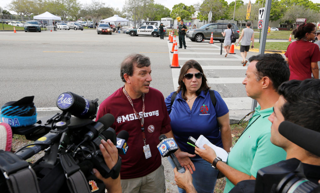 Mathematics teacher Jim Gard speaks with reporters at Marjory Stoneman Douglas High School in Parkland, Florida, U.S., February 23, 2018.  REUTERS/Joe Skipper - RC1706953FD0