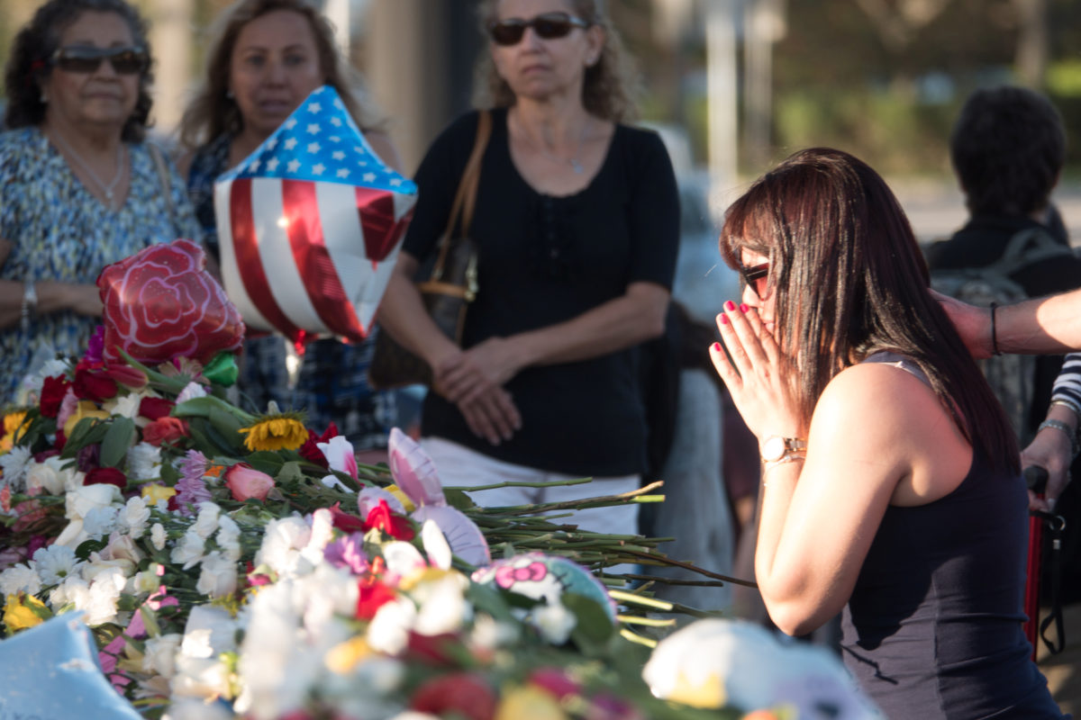 Well-wishers place mementos at the Marjory Stoneman Douglas High School following a mass shooting in Parkland, Florida. The school opens on Wednesday. Photo by Angel Valentin/Reuters
