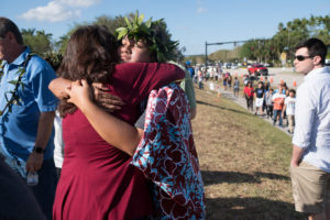 Students and parents arrive for voluntary campus orientation Sunday at the Marjory Stoneman Douglas High School, for the coming Wednesday's reopening, following last week's mass shooting in Parkland, Florida. Photo by Angel Valentin/Reuters