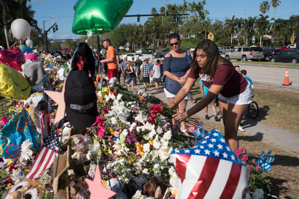 Well-wishers place mementos at the Marjory Stoneman Douglas High School in Parkland, Florida. Photo by Angel Valentin/Reuters