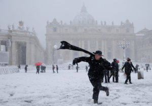 A priest throws a snowball in Saint Peter's Square at the Vatican on Feb. 26. Photo by Max Rossi/Reuters