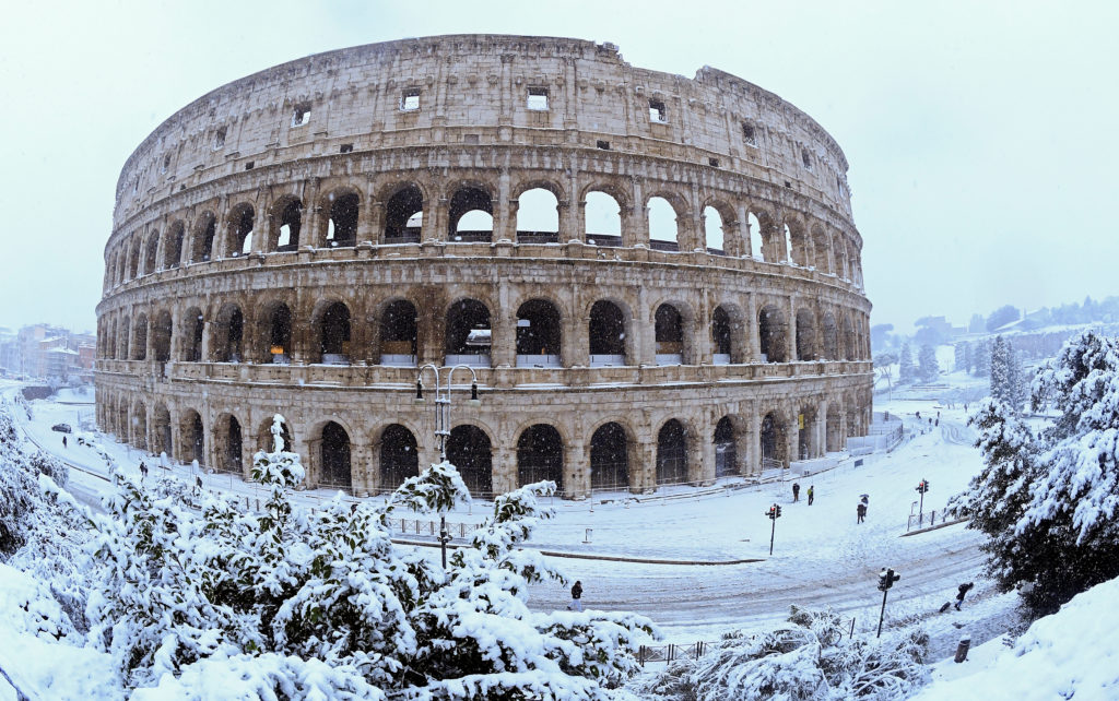 The Colosseum in Rome is covered in snow on Feb. 26. Photo by Alberto Lingria/Reuters