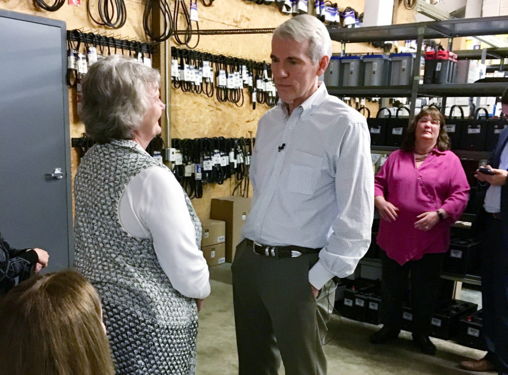U.S. Senator Rob Portman asks small business owners about how the Tax Cuts & Jobs Act effects their business during his tour of Ohio in Zanesville, Ohio, U.S., February 23, 2018.  Picture takes on February 23, 2018.   REUTERS/Kim Palmer - RC14B1760080