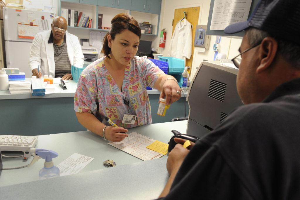 Pharmacy tech Maria Santoyo (C) works in Clinica Sierra Vista's Lamont Community Health center in Bakersfield, California....