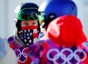 FILE PHOTO: U.S. snowboarder Shaun White waits in line during a breakdown of the chairlift at snowboard slopestyle training for the 2014 Sochi Winter Olympics in Rosa Khutor, February 3, 2014.Ê Ê REUTERS/Mike Blake/File Photo - RC170C633A70