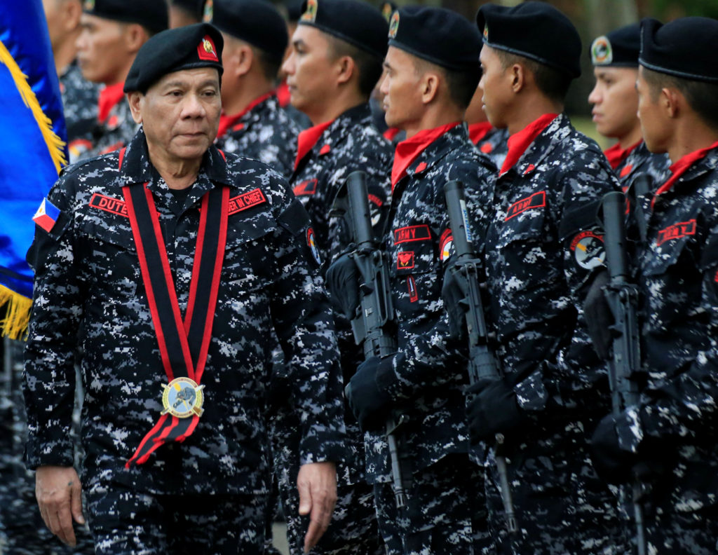 Philippine President Rodrigo Duterte, wearing a military uniform, reviews scout ranger troops upon his arrival during the 67th founding anniversary of the First Scout Ranger regiment in San Miguel town, Bulacan province, north of Manila, Philippines November 24, 2017. REUTERS/Romeo Ranoco - RC14E731E0C0