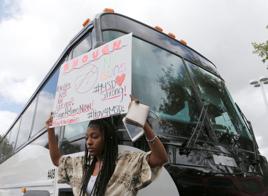 Tyra Hemans, 19, a senior at Marjory Stoneman Douglas High School students board buses to travel to Tallahassee, Florida to meet with legislators in Coral Springs, Florida, U.S. February 20, 2018. REUTERS/Joe Skipper - RC1570BAF070