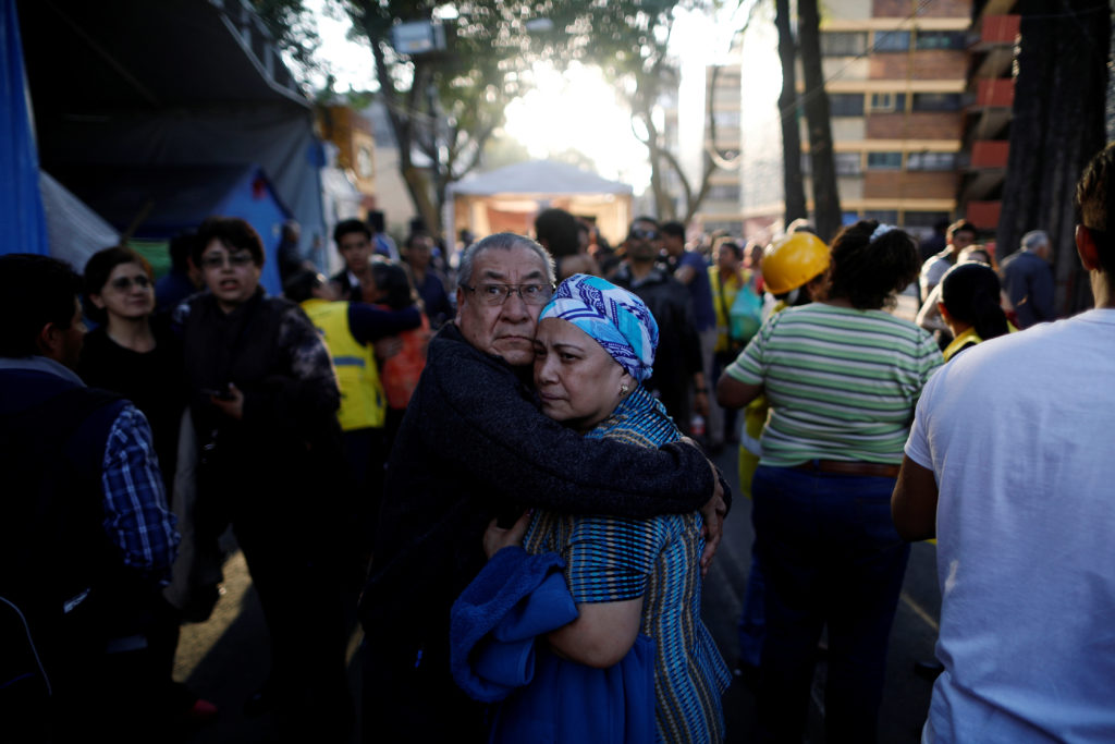 People react after an earthquake shook buildings in Mexico City, Me…