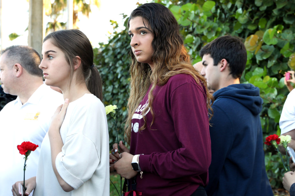 Students arrive at Marjory Stoneman Douglas High School for the first time since the mass shooting in Parkland, Florida, U.S., February 28, 2018. Photo by Mary Beth Koeth/REUTERS