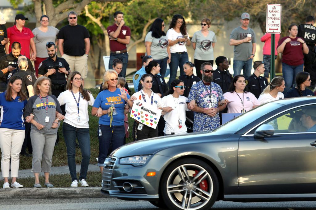 Local residents show their support as students arrive at Marjory Stoneman Douglas High School for the first time since the mass shooting in Parkland, Florida, U.S., February 28, 2018. Photo by Mary Beth Koeth/REUTERS