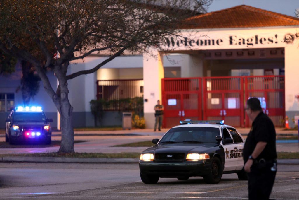 Police cars are seen parked outside Marjory Stoneman Douglas High School in support of students, as they begin arriving to school for the first time since the mass shooting in Parkland, Florida, U.S., February 28, 2018. Photo by Mary Beth Koeth/REUTERS