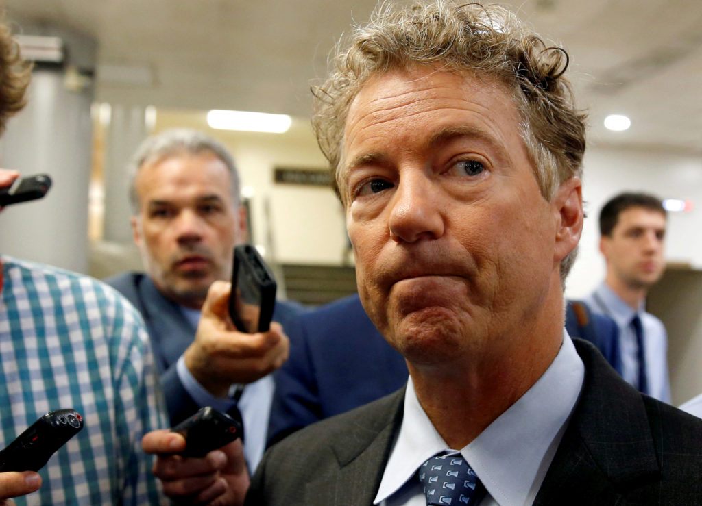 FILE PHOTO: Senator Rand Paul (R-KY) speaks to reporters after Senate Republicans unveiled their version of legislation that would replace Obamacare on Capitol Hill in Washington, U.S., June 22, 2017. REUTERS/Joshua Roberts/File Photo - RC163475AB00
