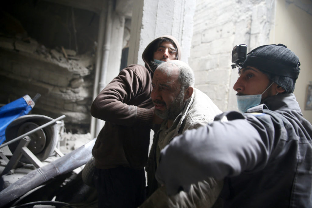Civil defence help a man from a shelter in the besieged town of Douma in eastern Ghouta in Damascus, Syria, February 22, 2018. REUTERS/Bassam Khabieh - RC13BD6E3DD0