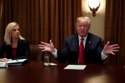 U.S. President Donald Trump, flanked by Secretary of Homeland Security Kirstjen Nielsen, meets with members of Congress and U.S. law enforcement about crime and immigration issues, specifically the MS-13 gang, at the White House in Washington, U.S. February 6, 2018. REUTERS/Jonathan Ernst - RC1C08636760