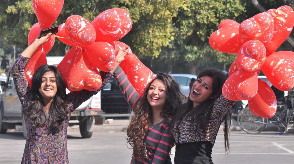 Relatives and friends enjoy Valentine's Day with heart-shaped balloons on February 14, 2015 in Panchkula, India. (Photo by...