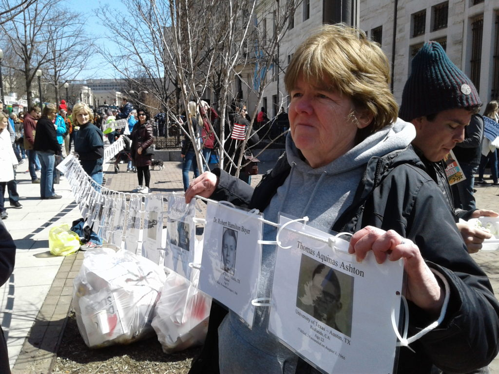 MaMaureen Glover made a line of obituaries of more than 200 people who have been victims of school shooting victims dating to the 1960s for the March for Our Lives in Washington, D.C. on Saturday, March 24, 2018. Photo by Michael Riosureen Glover made a line of obituaries of more than 200 people who have been victims of school shooting victims dating to the 1960s. Photo by Michael Rios