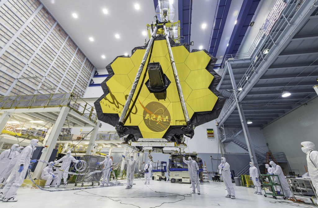 In this photo, NASA technicians lifted the telescope using a crane and moved it inside a clean room at NASA's Goddard Spac...