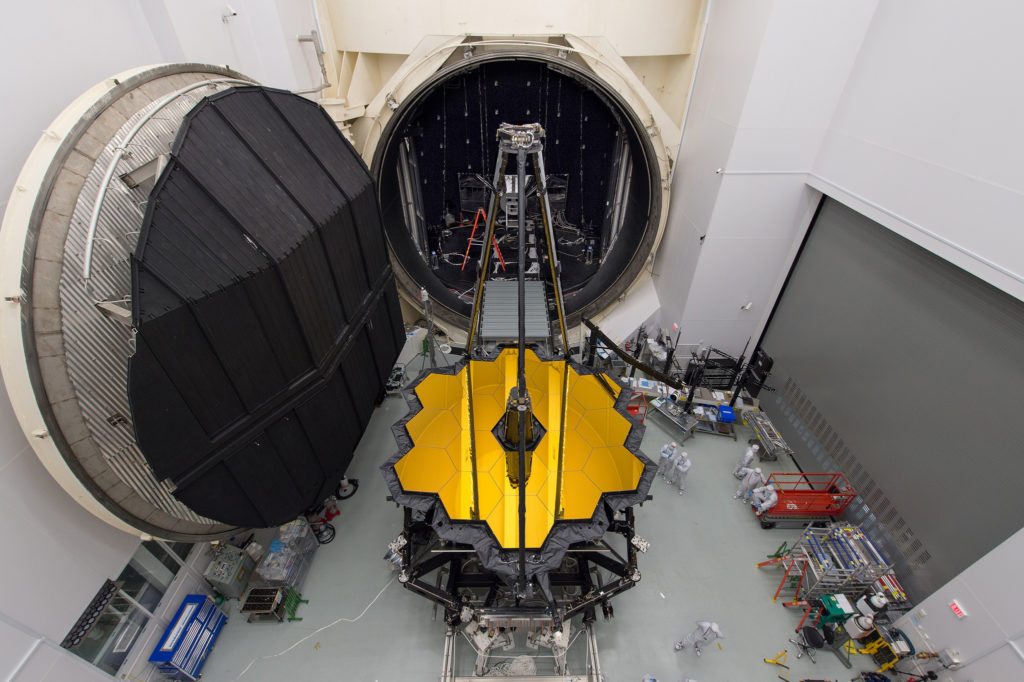 NASA's James Webb Space Telescope sits in front of the door to Chamber A, a giant thermal vacuum chamber located at NASA's Johnson Space Center. Photo by NASA/Desiree Stover