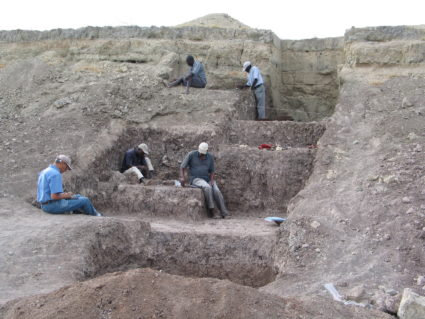 At this Olorgesailie Basin excavation site in Kenya, scientists found red ocher pigments with Middle Stone Age artifacts. The layers of soil provide evidence of the environmental change. Photo by Human Origins Program, Smithsonian