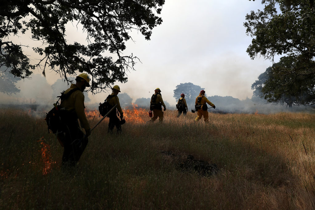 Firefighters monitor a controlled burn at Bouverie Preserve on May 30, 2017 in Glen Ellen, California. Cal Fire, U.S. Fore...