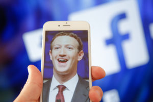 A portrait of Facebook found Mark Zuckerberg is seen on an iPhone in this photo illustration on 28 August, 2017. (Photo by Jaap Arriens/NurPhoto via Getty Images)