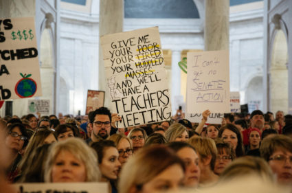 Striking school workers hold signs and chant inside the West Virginia Capitol last week in Charleston, West Virginia. Photo by Scott Heins/Bloomberg via Getty Images