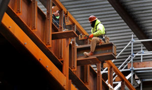 BOSTON, MA - MARCH 6: A construction worker works on a beam at The Hub on Causeway next to TD Garden in Boston on March 6, 2018. (Photo by David L. Ryan/The Boston Globe via Getty Images)