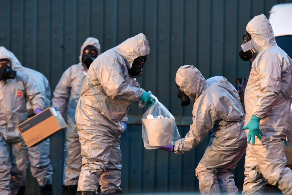 SALISBURY, ENGLAND - MARCH 08: Forensic police officers wearing hazmat suits examine a vehicle believed to belong to Sergei Skripal on March 8, 2018 in Salisbury, England. Police investigations continue into the use of a nerve agent to poison Sergei Skripal, who was found ill in a Salisbury park with his daughter on March 4. Both Sergei Skripal and his daughter remain in critical condition in hospital. Sergei Skripal was granted refuge in the UK following a spy swap between the US and Russia in 2010. (Photo by Rufus Cox/Getty Images)