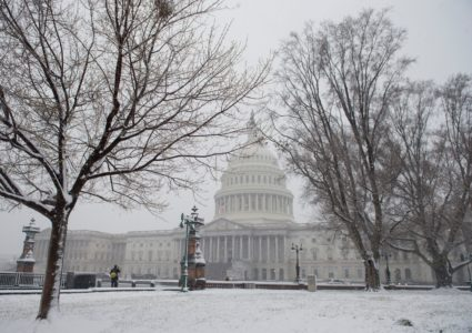 Snow falls at the US Capitol during a snow storm in Washington, DC, March 21, 2018. The fourth Noreaster in less than three weeks, Winter Storm Toby, is throwing a fresh blanket of snow just as spring begins. The storm caused heavy damaged in the south with hail, high winds and tornadoes. / AFP PHOTO / SAUL LOEB (Photo credit should read SAUL LOEB/AFP/Getty Images)