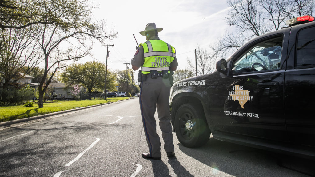 Police barricade the area surrounding the home of suspected Austin bomber Mark Anthony Conditt March 21, 2018 in Pflugervi...
