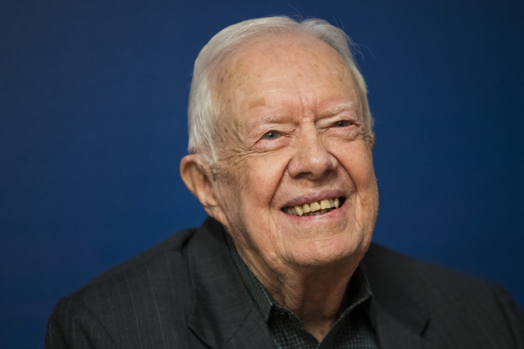NEW YORK, NY - MARCH 26: Former U.S. President Jimmy Carter smiles during a book signing event for his new book 'Faith: A ...