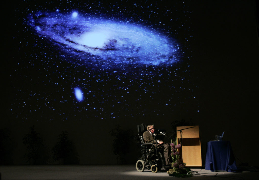"British physicist Stephen Hawking delivers a lecture on ""The Origin of the Universe"" at the Heysel conference hall in Brussels May 20, 2007. Photo by Francois Lenoir/REUTERS"