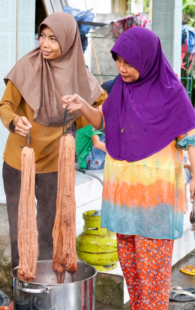 Women in Indonesia dye yarn to generate income. Photo courtesy of World Neighbors