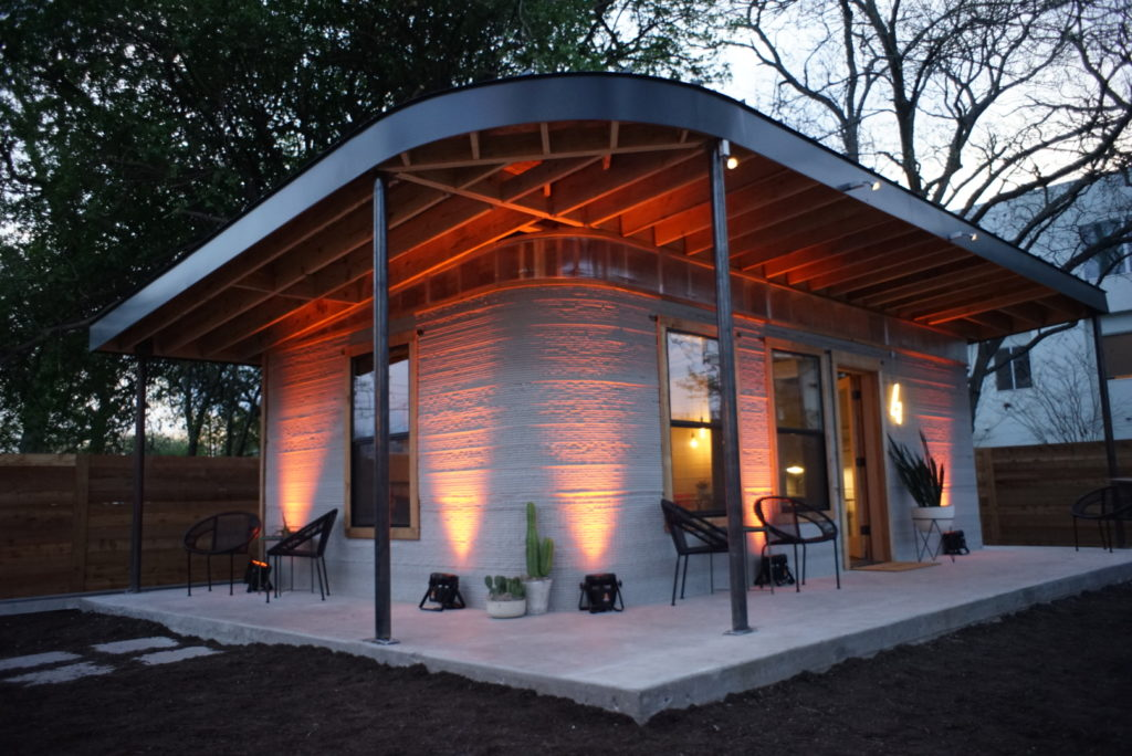 This 3D-printed home is a petite replica of the houses that will soon shelter underserved families throughout the world. Courtesy of New Story and ICON